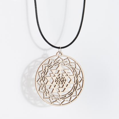 Sri Yantra necklace birch wood hanging isolated